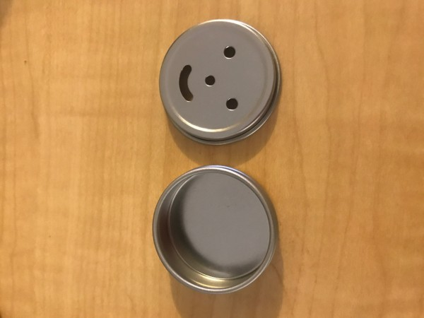 Small smiley face tin